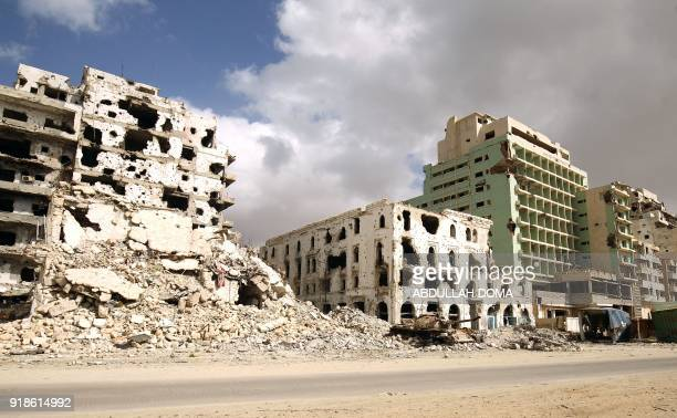 A picture taken on February 15 2018 shows a view of destroyed buildings along the seaside promenade of Libya's eastern city of Benghazi near the...