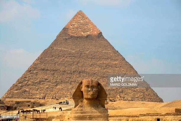 A picture taken on February 15 2018 shows a view of the Pyramid of Khafre and the Giza Sphinx at the Giza pyramids complex on the southwestern...