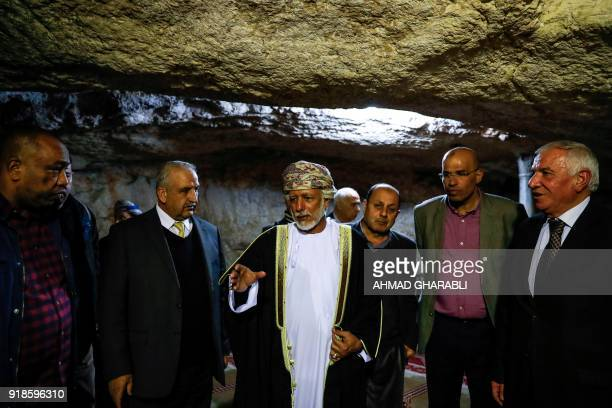 A picture taken on February 15 2018 shows Omani minister responsible for foreign affairs Yusuf bin Alawi standing inside the cave beneath the Dome of...