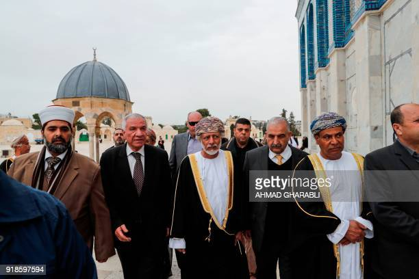 A picture taken on February 15 2018 shows Omani minister responsible for foreign affairs Yusuf bin Alawi walking next to AlAqsa mosque during his...