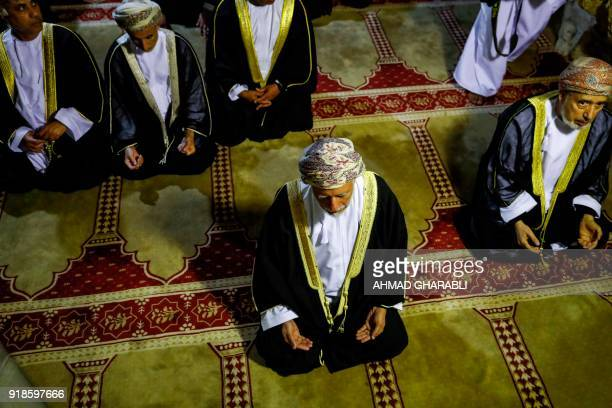 A picture taken on February 15 2018 shows Omani minister responsible for foreign affairs Yusuf bin Alawi performing prayers inside the cave beneath...