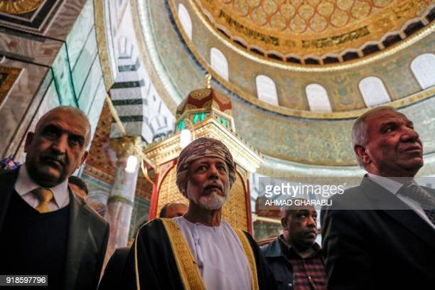 A picture taken on February 15 2018 shows Omani minister responsible for foreign affairs Yusuf bin Alawi standing inside the Dome of the Rock during...