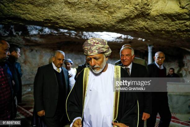 A picture taken on February 15 2018 shows Omani minister responsible for foreign affairs Yusuf bin Alawi walking inside the cave beneath the Dome of...