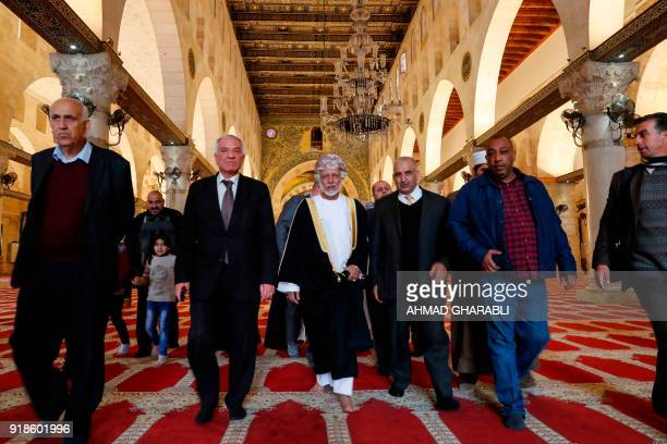 A picture taken on February 15 2018 shows Omani minister responsible for foreign affairs Yusuf bin Alawi walking inside AlAqsa mosque during his...