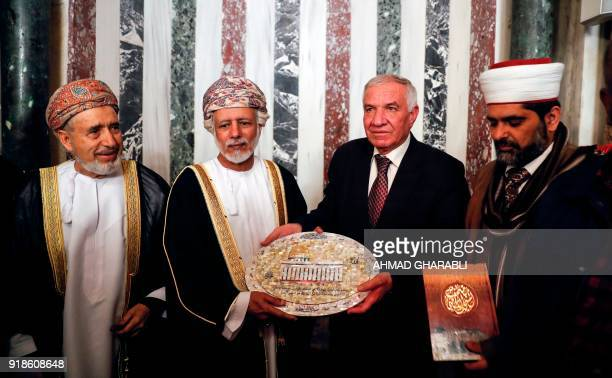A picture taken on February 15 2018 shows Omani minister responsible for foreign affairs Yusuf bin Alawi being presented with a mosaic plaque...
