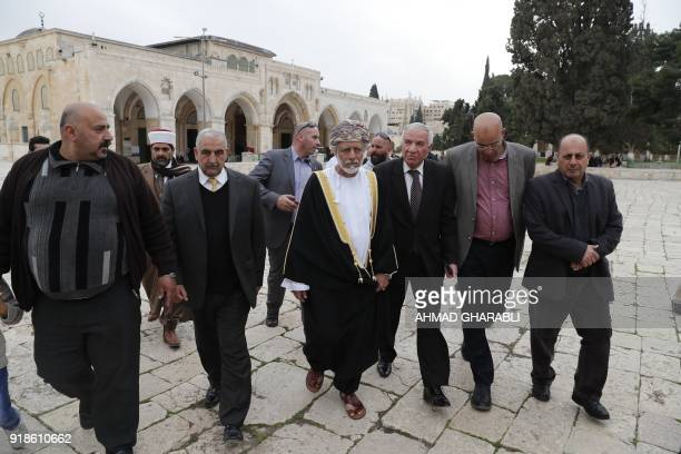 A picture taken on February 15 2018 shows Omani minister responsible for foreign affairs Yusuf bin Alawi walking through AlAqsa mosque compound with...