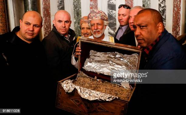 A picture taken on February 15 2018 shows Omani minister responsible for foreign affairs Yusuf bin Alawi presenting an Omani gift of incense during...