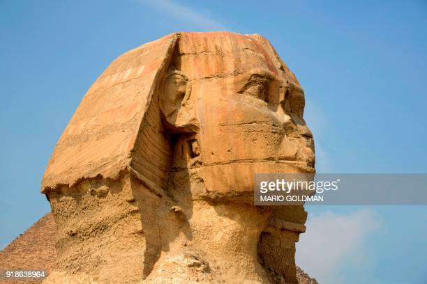 A picture taken on February 15 2018 shows the head of the Giza Sphinx at the Giza pyramids complex on the southwestern outskirts of the Egyptian...