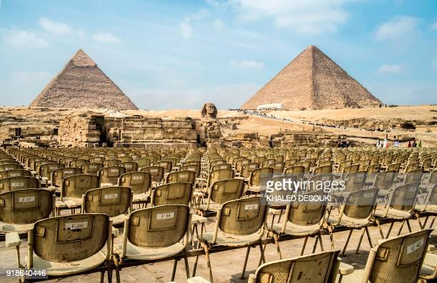 A picture taken on February 15 2018 shows the 'sound and light' amphitheatre at the Giza Pyramids complex during the day with the Great Pyramid of...