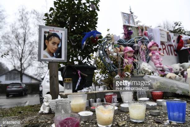 A picture taken on February 15 in Le PontdeBeauvoisin shows a picture of eightyearold Maelys de Araujo candles toys and messages displayed in tribute...