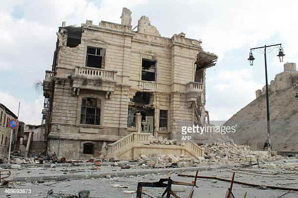 Picture taken on February 16, 2014 shows a heavily damaged building below Aleppo's historical citadel . More than 136,000 people have been killed...