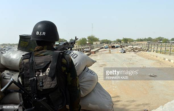A picture taken on February 17 2015 shows a Cameroonian soldier standing post in the Cameroonian town of Fotokol on the border with Nigeria after...