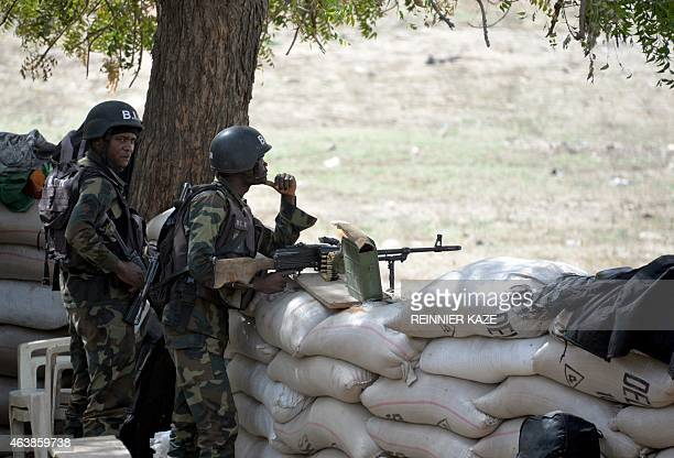A picture taken on February 17 2015 shows Cameroonian soldiers standing post in the Cameroonian town of Fotokol on the border with Nigeria after...