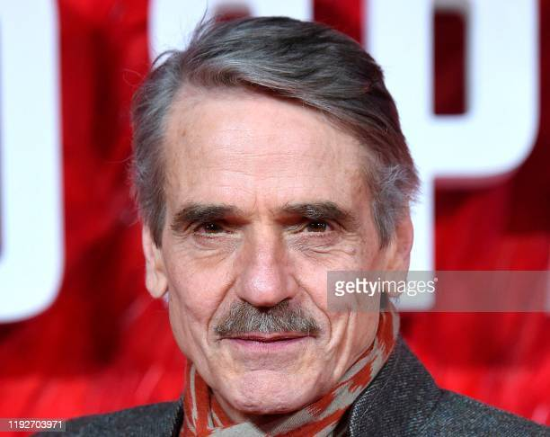 Picture taken on February 19 2018 shows British actor Jeremy Irons posing on the red carpet on arrival to attend the European premiere of the film...