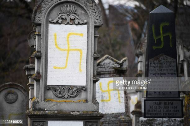 A picture taken on February 19 2019 shows graves vandalised with swastikas at the Jewish cemetery in Quatzenheim on the day of a nationwide marches...