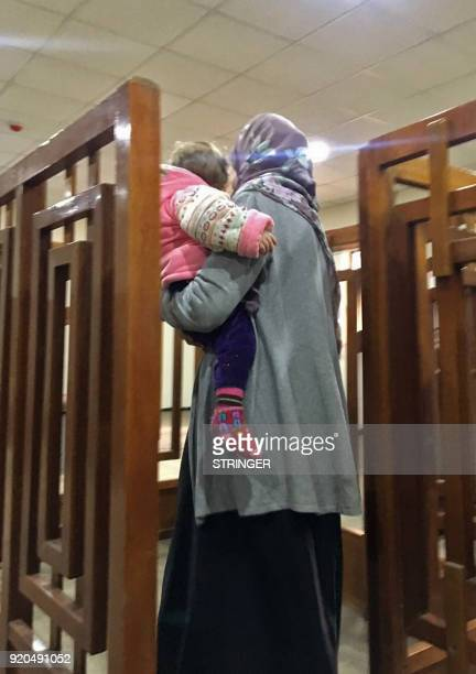 A picture taken on February 19 shows French Jihadist Melina Boughedir carrying her son as she arrives to court in the Iraqi capital Baghdad Melina...
