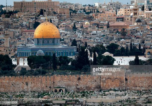 A picture taken on February 19 shows the Golden Gate also known as the Mercy Gate and the Dome of the Rock at the AlAqsa mosques compound in...