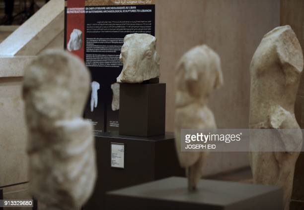 A picture taken on February 2 2018 shows a marble sculpture of a bull's head dating back to the 4th century BC among other repatriated artefacts...