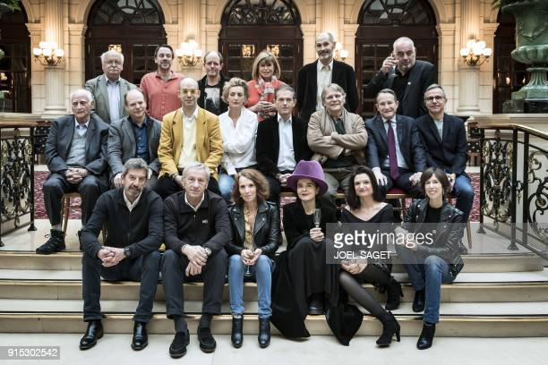 A picture taken on February 2 2018 shows the most read authors in 2017 according to the Palmares RTLL'Express hitlist as they pose during a photo...