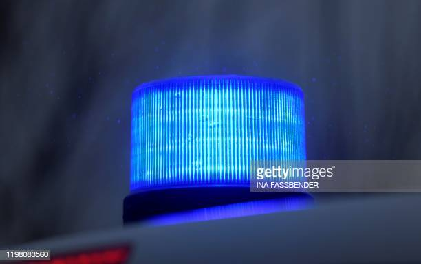 Picture taken on February 2, 2020 shows a flashing blue light of a police car in Datteln, western Germany.