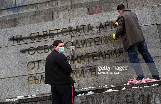 Picture taken on February 20, 2011 shows members of Bulgarian Socialist Party cleaning the Soviet Army monument in Sofia. Over two decades after the...