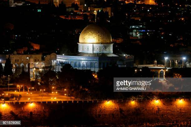 TOPSHOT A picture taken on February 20 2018 from the Mount of Olives shows a partial view of the Jerusalem's Old City with the Dome of the Rock in...