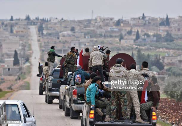 TOPSHOT A picture taken on February 20 2018 shows a convoy of proSyrian government fighters arriving in Syria's northern region of Afrin Kurdish...