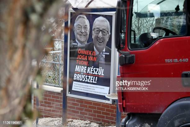 A picture taken on February 20 2019 in Budapest shows a billboard bearing portraits of European Commission chief JeanClaude Juncker and Hungarianborn...