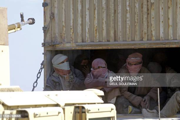 TOPSHOT A picture taken on February 20 2019 shows a truck carrying men identified as Islamic State group fighters who surrendered to Kurdishled...
