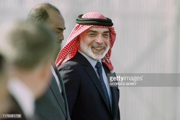 Picture taken on February 21, 1991 at Amman showing King Hussein of Jordan welcoming Sudanese military ruler Omar al-Bashir .