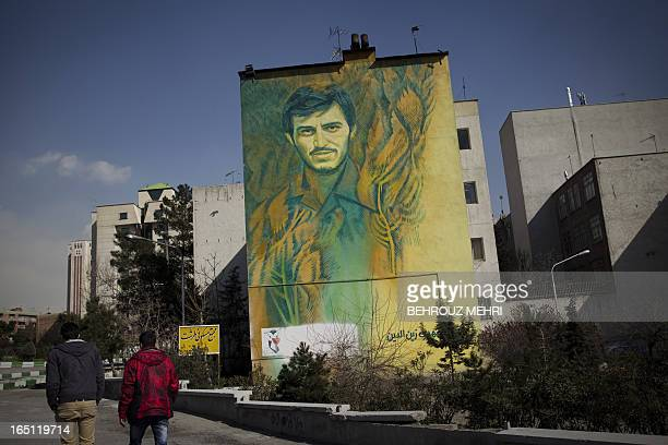 """Picture taken on February 21, 2012 shows a mural painting west of the Iranian capital Tehran, depicting """"martyr"""" Mehdi Zeneddin who was killed during..."""