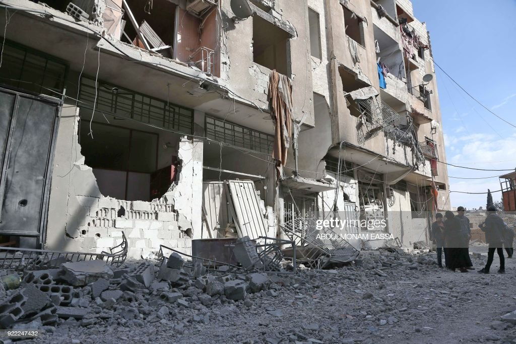 A picture taken on February 21, 2018 shows a view of the exterior of a destroyed hospital that was hit in a reported regime air strike in the rebel-held enclave of Hamouria in the Eastern Ghouta ne...