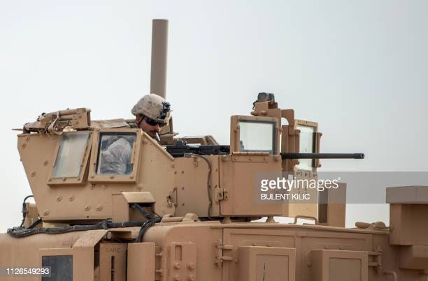 A picture taken on February 21 2019 shows a US soldier atop an armoured vehicle on a road in Syria's northern Deir Ezzor province USbacked Syrian...