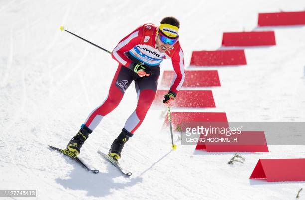 Picture taken on February 21 2019 shows Austrian crosscountry skier Dominik Baldauf competing in the Men's crosscountry event at the FIS Nordic World...