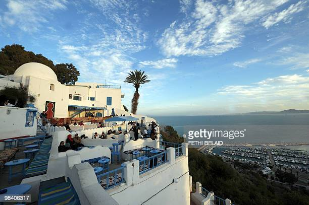 A picture taken on February 22 2010 shows tourists and residents arriving at the 'Cafe des Delices'in the village of Sidi Bou Said overlooking the...