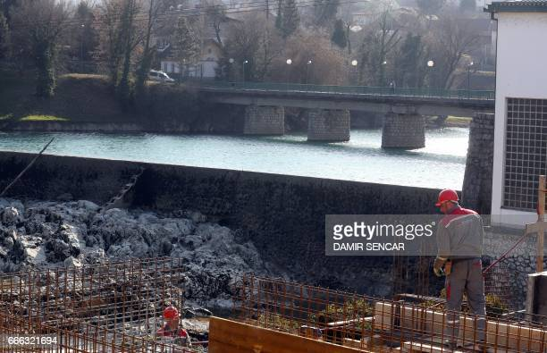 Picture taken on February 22, 2017 shows a man working on the construction of the hydro plant on the river Kupa in town of Ozalj near Karlovac,...