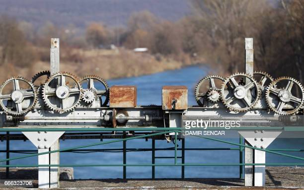 Picture taken on February 22, 2017 shows gears for raising the dam on an hydro plant on the river Kupa in the town of Ozalj, near Karlovac, Croatia....