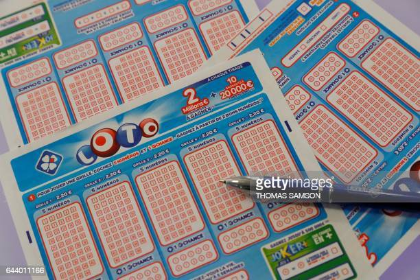 A picture taken on February 23 2017 in Paris shows lottery game grids of Française des Jeux the operator of France's national lottery games after the...