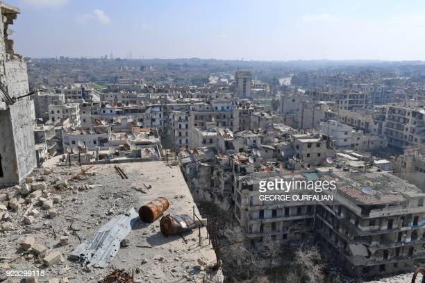 A picture taken on February 23 2018 from an elevated position shows a general view of Sheikh Maqsoud neighbourhood in the northern Syrian city of...