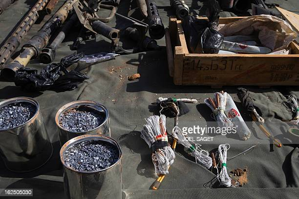 Picture taken on February 24, 2013 in the centre of Gao shows material use to make IED explosive seized from Islamist fighters by the Malian army....
