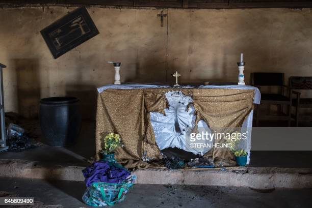 A picture taken on February 24 2017 shows the damaged alter of Saint Moses Catholic Church in the village of Bakin Kogi in Kaduna state northwest...