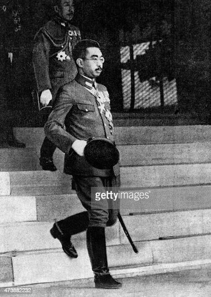 A picture taken on February 25 1942 Japanese Emperor Hirohito stepping out of Tokyo Yasukuni Temple where he attended a celebration for soldiers...