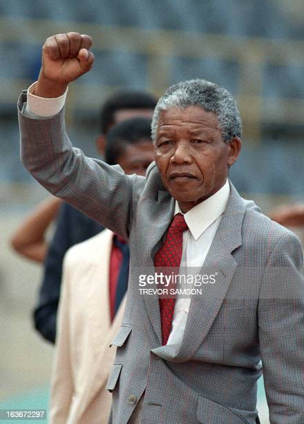 A picture taken on February 25 1990 shows antiapartheid leader and African National Congress member Nelson Mandela raising a clenched fist as he...