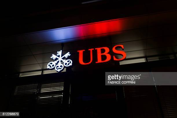 A picture taken on February 25 2016 shows the logo of the Swiss global financial services company UBS at the entrance of a branch's building in...