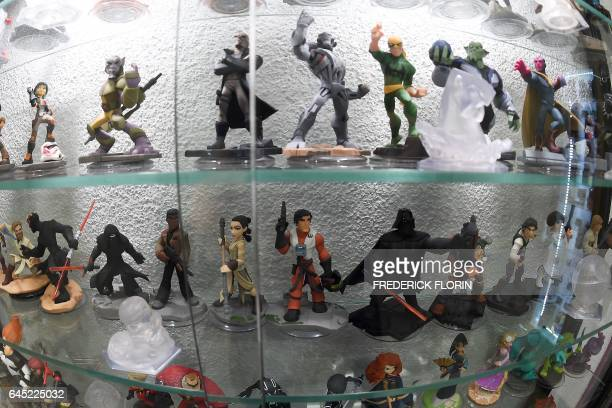 A picture taken on February 25 2017 shows figurines of video games displayed at the 'Pixel Museum' the museum of video games connected leisure and...