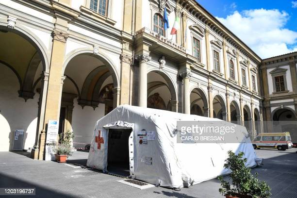 Picture taken on February 25, 2020 shows a pre-triage medical tent in front of Santa Maria Nuova Hospital in Florence as Tuscany reported its first...