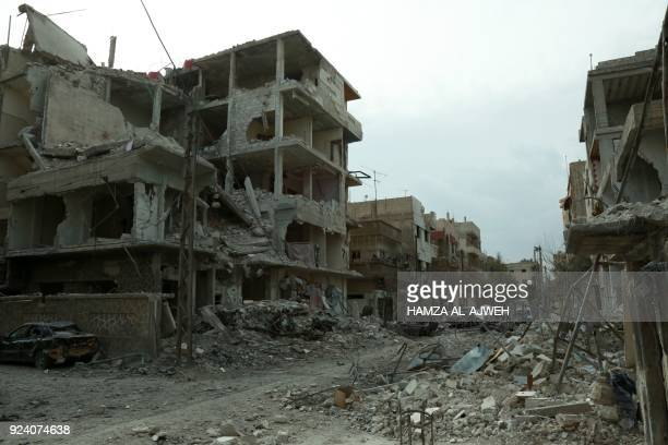 A picture taken on February 25 shows damaged buildings following regime air strikes in the Syrian rebelheld town of Douma in the besieged Eastern...