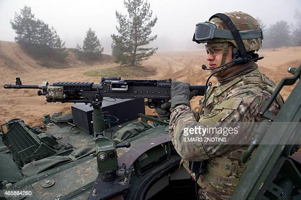 COLLIER Picture taken on February 26 2015 shows a soldier manning a gun on an armored fighting vehicle IAV Stryker of the US Cavalry Regiment 2nd...