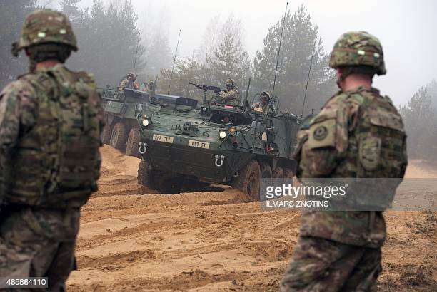 COLLIER Picture taken on February 26 2015 shows armored fighting vehicles IAV Stryker of the US Cavalry Regiment 2nd subdivision during training with...