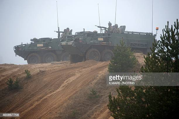 COLLIER Picture taken on February 26 2015 shows armored fighting vehicles IAV Stryker of the US Cavalry Regiment 2nd subdivision during a partner...